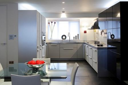 Modern-compact-kitchen-interior-with-white-cabinetry